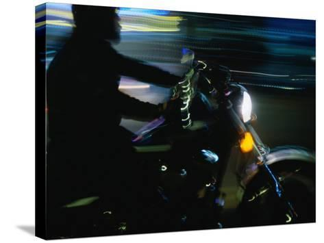 Motorbike on Main Street at Bike Week, Daytona Beach, Florida, USA-Lawrence Worcester-Stretched Canvas Print