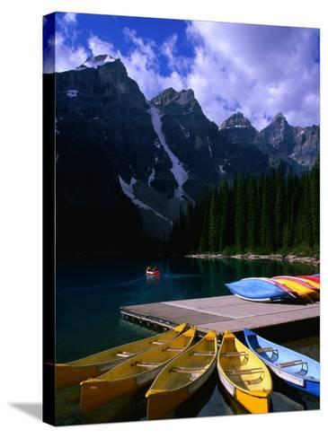 Canoeing on Moraine Lake, Banff National Park, Alberta, Canada-Lawrence Worcester-Stretched Canvas Print