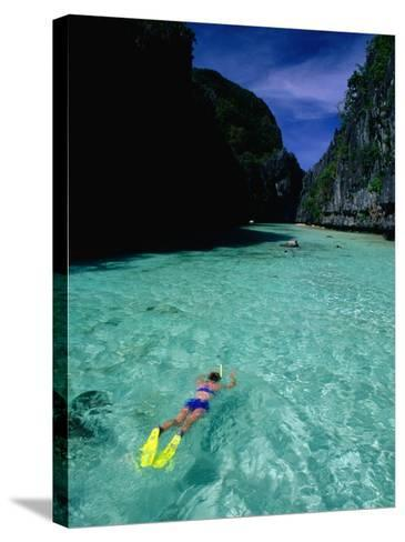 Snorkelling in the Big Lagoon, El Nido, Miniloc Island, Palawan, Philippines-Mark Daffey-Stretched Canvas Print