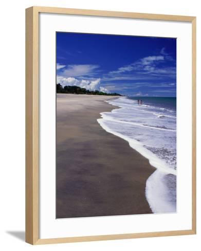 Distant Couple Walking on Beach, Santa Clara, Panama-Alfredo Maiquez-Framed Art Print