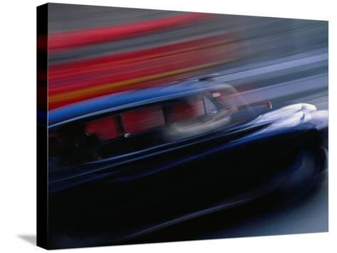 Black London Taxi Cab Moving Alongside Double-Decker Bus, London, England-Angus Oborn-Stretched Canvas Print