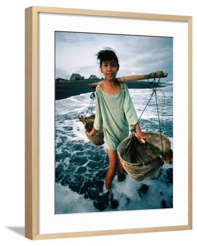 A Girl Gathers Salt Water in Lontar Leaf Buckets for Salt Making, Kusamba, Indonesia-Adams Gregory-Framed Art Print