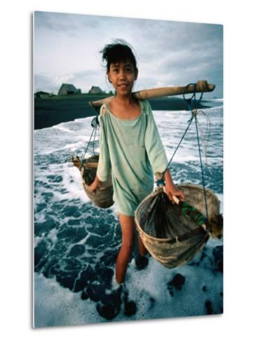 A Girl Gathers Salt Water in Lontar Leaf Buckets for Salt Making, Kusamba, Indonesia-Adams Gregory-Metal Print