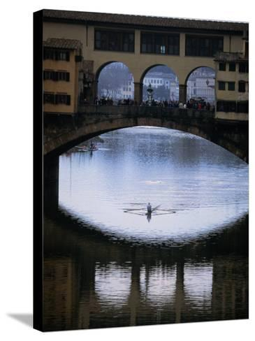 Rower on Arno River Passing Beneath Ponte Vecchio, Florence, Tuscany, Italy-Doug McKinlay-Stretched Canvas Print