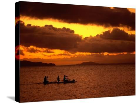Sunset Over the Sea with an Outrigger in Silhouette, Upolu, Samoa, Upolu-Peter Hendrie-Stretched Canvas Print