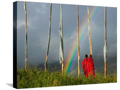 Rainbow and Monks with Praying Flags, Phobjikha Valley, Gangtey Village, Bhutan-Keren Su-Stretched Canvas Print
