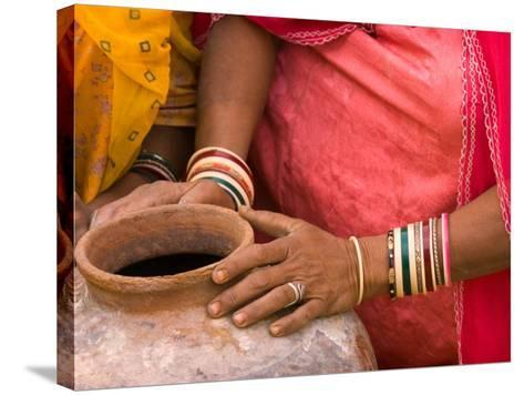 Woman's Hands on a Pottery Jug for Carrying Water, Thar Desert, Jaisalmer, Rajasthan, India-Philip Kramer-Stretched Canvas Print