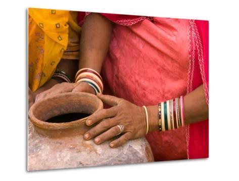 Woman's Hands on a Pottery Jug for Carrying Water, Thar Desert, Jaisalmer, Rajasthan, India-Philip Kramer-Metal Print