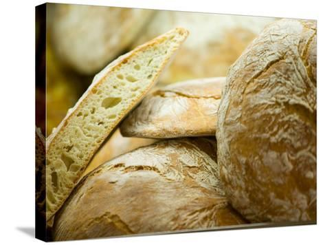 Fresh Bread, Trogir, Croatia-Russell Young-Stretched Canvas Print