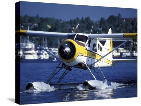 Float Plane Taxiing to Terminal on Lake Union, Washington, USA-William Sutton-Stretched Canvas Print