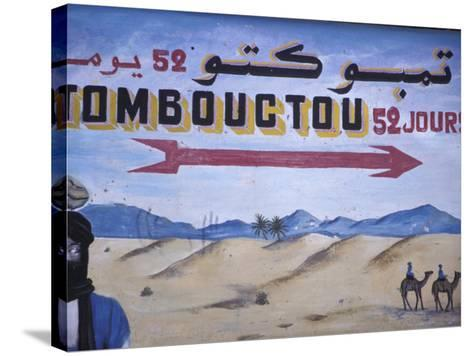 Colorful Sign Showing Way to Timbuktu, Morocco-John & Lisa Merrill-Stretched Canvas Print