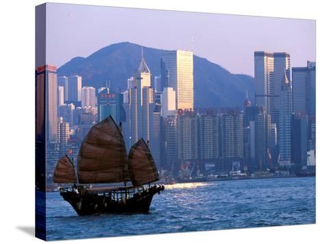 Junk Sailing in Hong Kong Harbor, Hong Kong, China-Paul Souders-Stretched Canvas Print