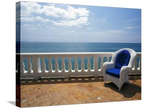 Wicker Chair and Tiled Terrace at the Hornet Dorset Primavera Hotel, Puerto Rico-Michele Molinari-Stretched Canvas Print