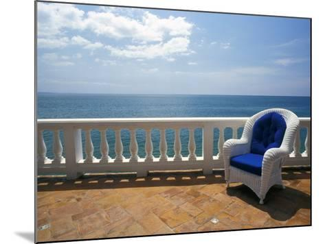 Wicker Chair and Tiled Terrace at the Hornet Dorset Primavera Hotel, Puerto Rico-Michele Molinari-Mounted Photographic Print