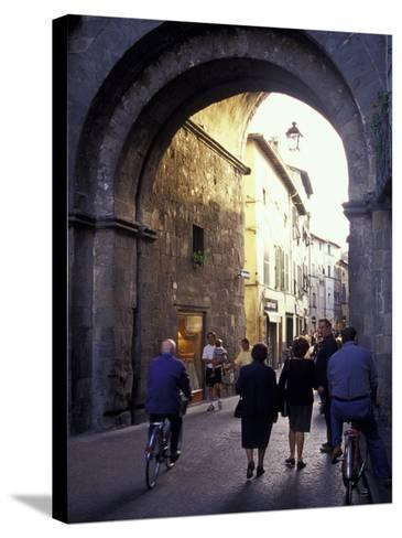 Pedestrians Entering Archway, Lucca, Italy-John & Lisa Merrill-Stretched Canvas Print