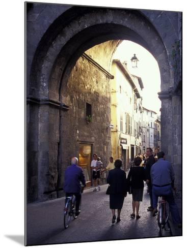 Pedestrians Entering Archway, Lucca, Italy-John & Lisa Merrill-Mounted Photographic Print