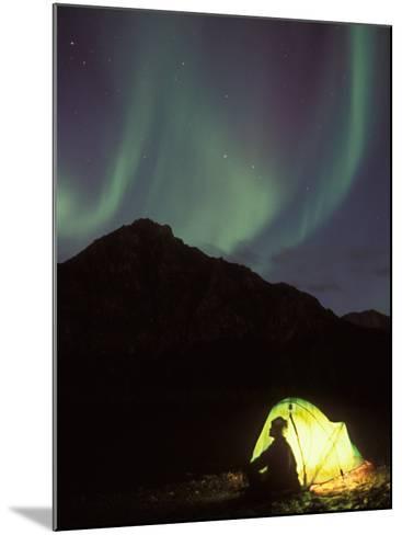 Northern Lights and Camper Outside Tent, Brooks Range, Arctic National Wildlife Refuge, Alaska, USA-Steve Kazlowski-Mounted Photographic Print