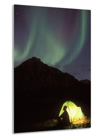 Northern Lights and Camper Outside Tent, Brooks Range, Arctic National Wildlife Refuge, Alaska, USA-Steve Kazlowski-Metal Print