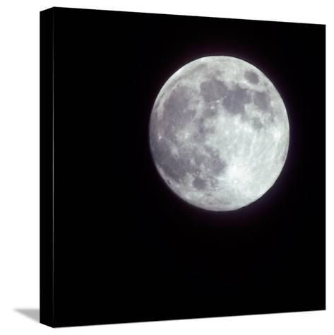 Bright Full Moon in a Black Night Sky-Janis Miglavs-Stretched Canvas Print