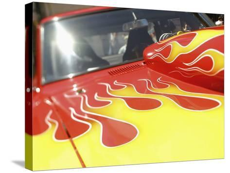 Close-up Image of a Flame Design on a Car Hood--Stretched Canvas Print