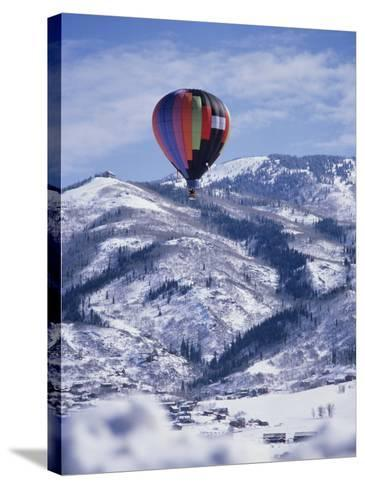 Colorful Hot Air Balloon Against Winter Landscape--Stretched Canvas Print