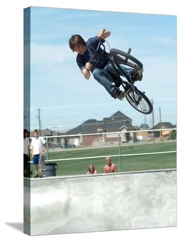 Performing a Bicycle Stunt--Stretched Canvas Print