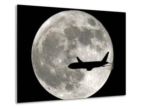 A Jet Plane Passes in Front of the Full Moon Above Surfside, Fla.--Metal Print