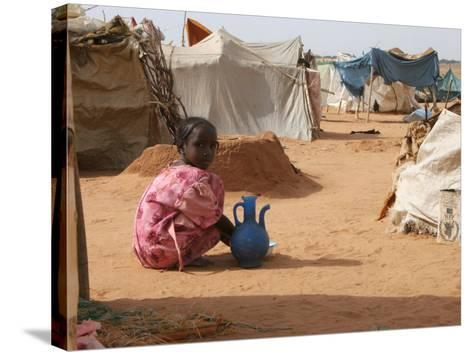 A Girl Washes Plates for Her Family in the North Darfur Refugee Camp of El Sallam October 4, 2006-Alfred De Montesquiou-Stretched Canvas Print