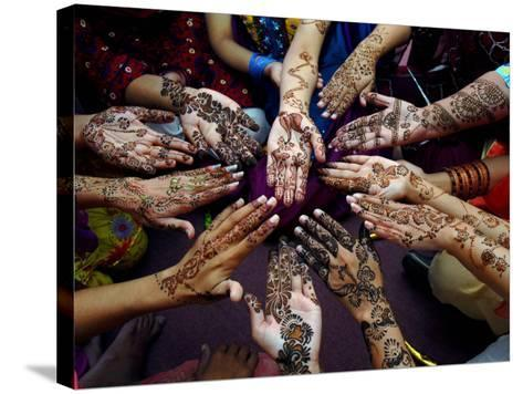 Pakistani Girls Show Their Hands Painted with Henna Ahead of the Muslim Festival of Eid-Al-Fitr-Khalid Tanveer-Stretched Canvas Print