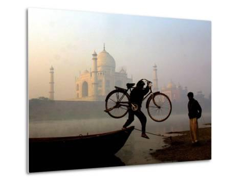 An Unidentified Cyclist Gets Down with His Cycle against the Backdrop of the Taj Mahal--Metal Print