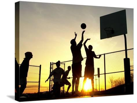 Students Play a Basketball Game as the Sun Sets at Bucks County Community College--Stretched Canvas Print