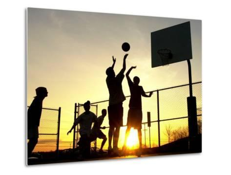 Students Play a Basketball Game as the Sun Sets at Bucks County Community College--Metal Print