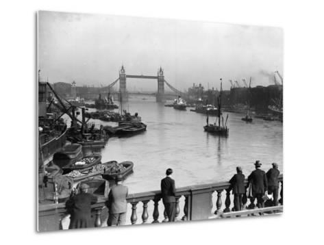 Pedestrians on London Bridge Watch Boats and Barges Being Unloaded--Metal Print
