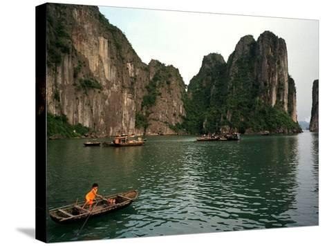 Boats Move Among the Craggy Islands of Halong Bay--Stretched Canvas Print