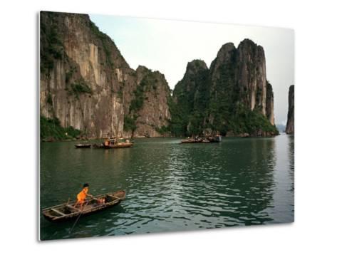 Boats Move Among the Craggy Islands of Halong Bay--Metal Print