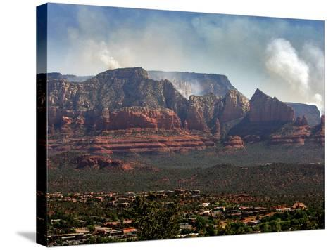 Sedona, Ariz. is Backdropped by the Brins Fire Buring Atop the Red Rocks--Stretched Canvas Print