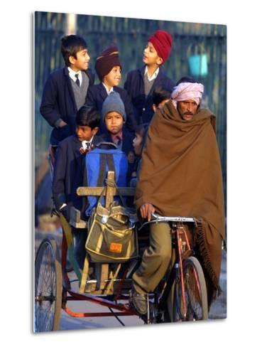Indian Children Ride to School on the Back of a Cycle Rickshaw--Metal Print