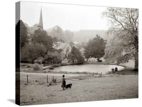 A Woman Walking Her Border Collie Dog in the Countryside--Stretched Canvas Print