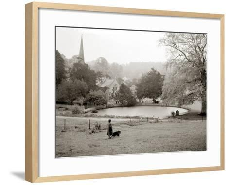 A Woman Walking Her Border Collie Dog in the Countryside--Framed Art Print