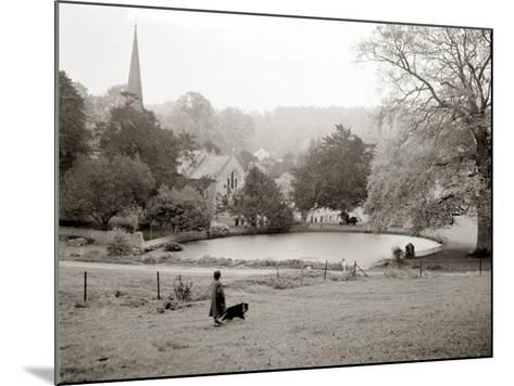 A Woman Walking Her Border Collie Dog in the Countryside--Mounted Photographic Print