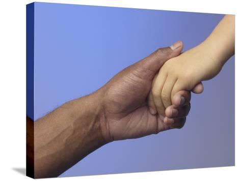 Adult Holding Child's Hand--Stretched Canvas Print