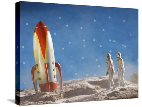 Astronaut Figurines Walking Towards Rocket--Stretched Canvas Print