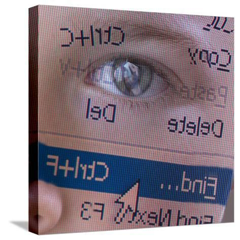 Person's Face with Superimposition of Backwards Computer Toolbar--Stretched Canvas Print
