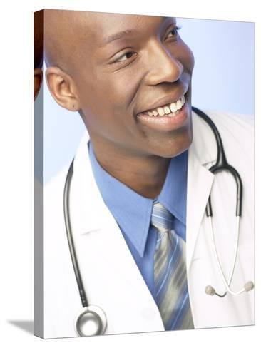 Smiling Doctor with Stethoscope Around His Neck--Stretched Canvas Print