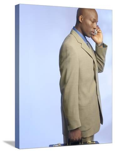 Businessman Talking on Cell Phone--Stretched Canvas Print