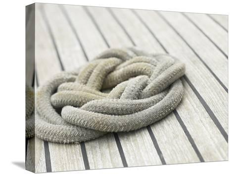 Knot of Rope on Wooden Boat Deck--Stretched Canvas Print