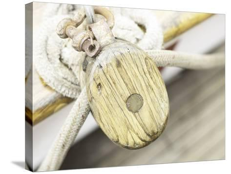 Wooden Pulley and Rope on Edge of Boat--Stretched Canvas Print