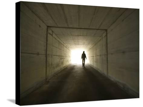 Person Walking Through Tunnel Towards Light--Stretched Canvas Print