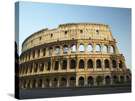 Ruins of the Coliseum in Rome Against Blue Sky--Stretched Canvas Print