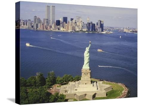 The Statue of Liberty and the New York Skyline--Stretched Canvas Print